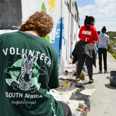 Volunteers in South Africa assist with community maintenance work